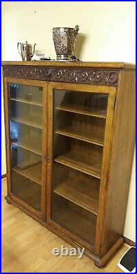 19th C Gothic figural carved bookcase with glass front doors