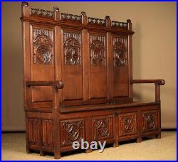 Antique Large Gothic Carved Oak Box Settle c. 1920