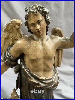 RARE 17th CENTURY OAK CARVED FIGURE OF WINGED SAINT AND CHILD