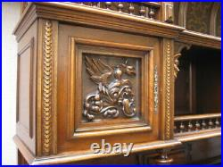 The DEVIL is the details 19th. Century carved French walnut buffet